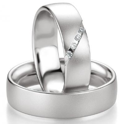 Partnerringe: Silber für den Herren, mit Diamanten für die Dame