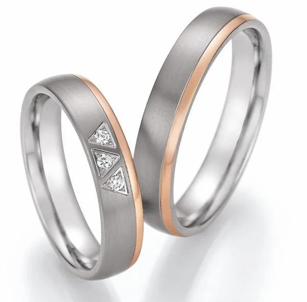partnerringe-starlight-vii-aus-titan-gold-diamant